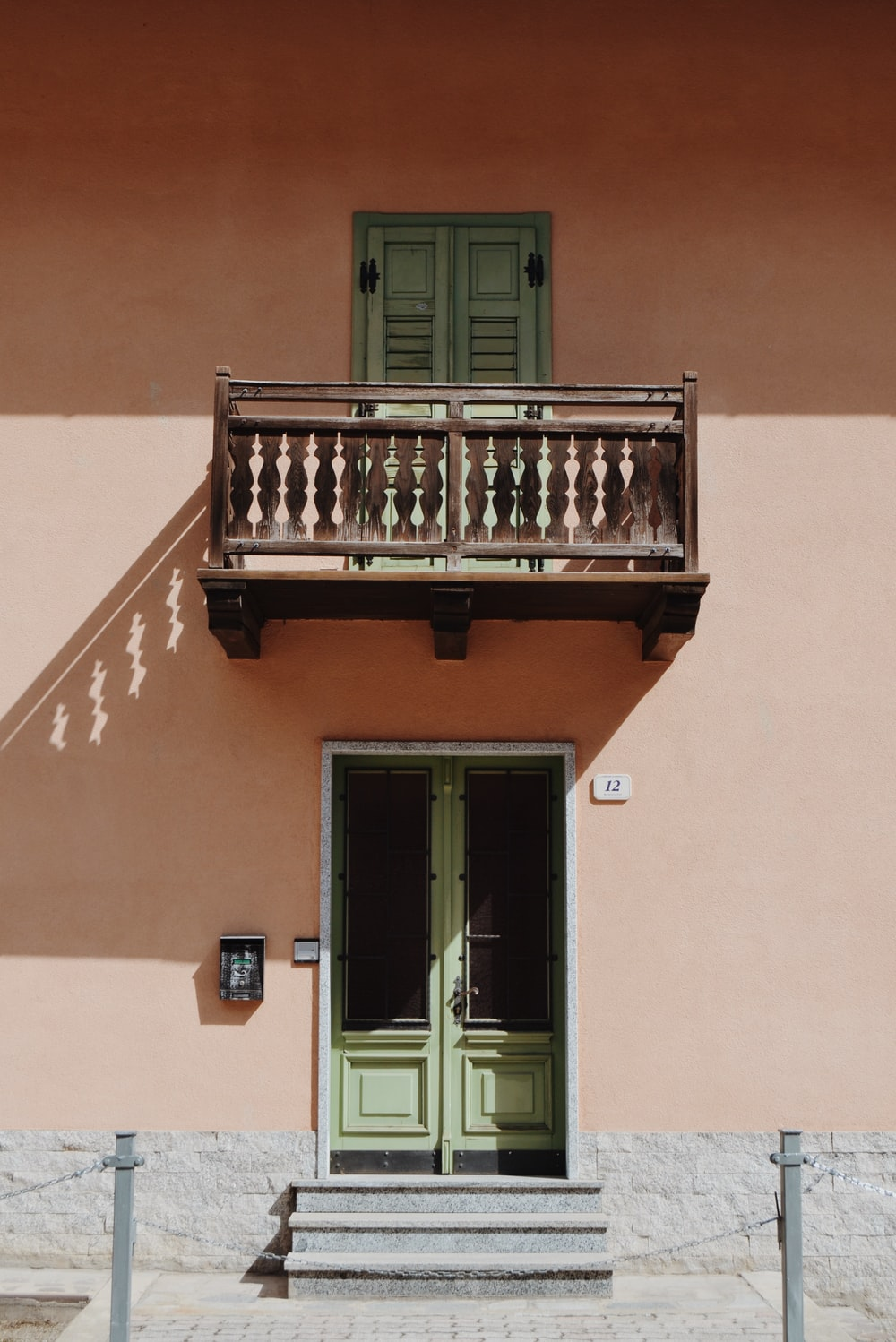 brown wooden terrace on pink wall