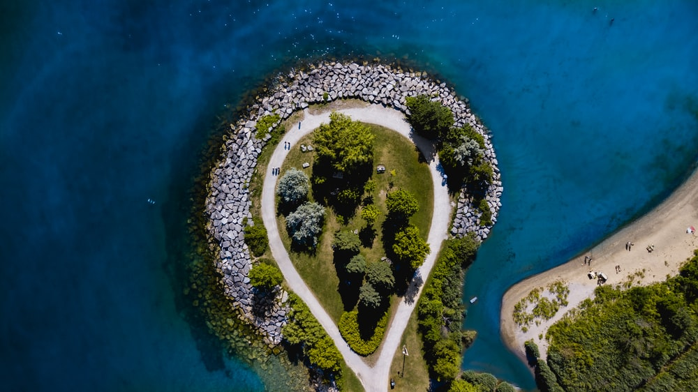 aerial view photography of island surrounded by sea