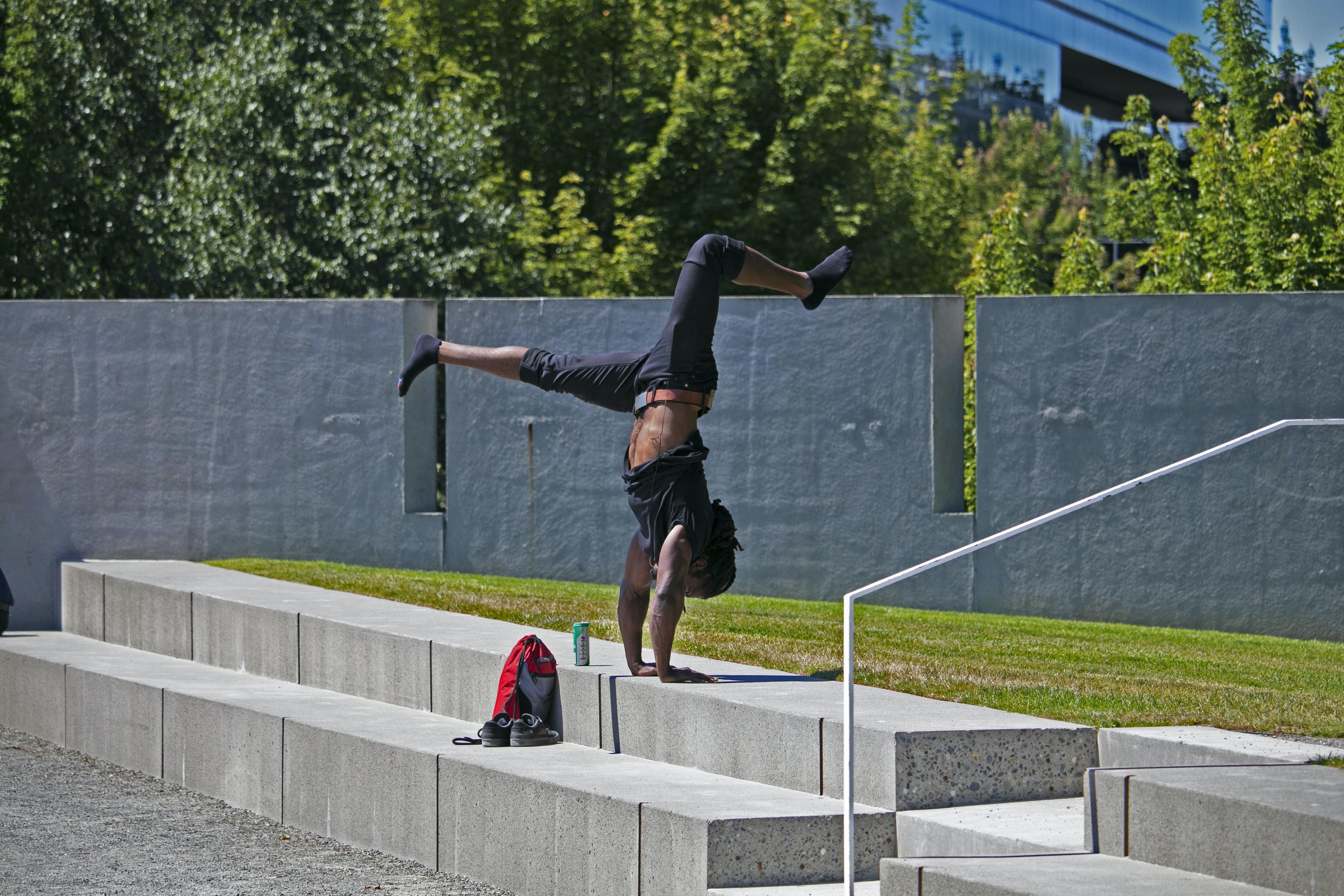 man break dancing on stair