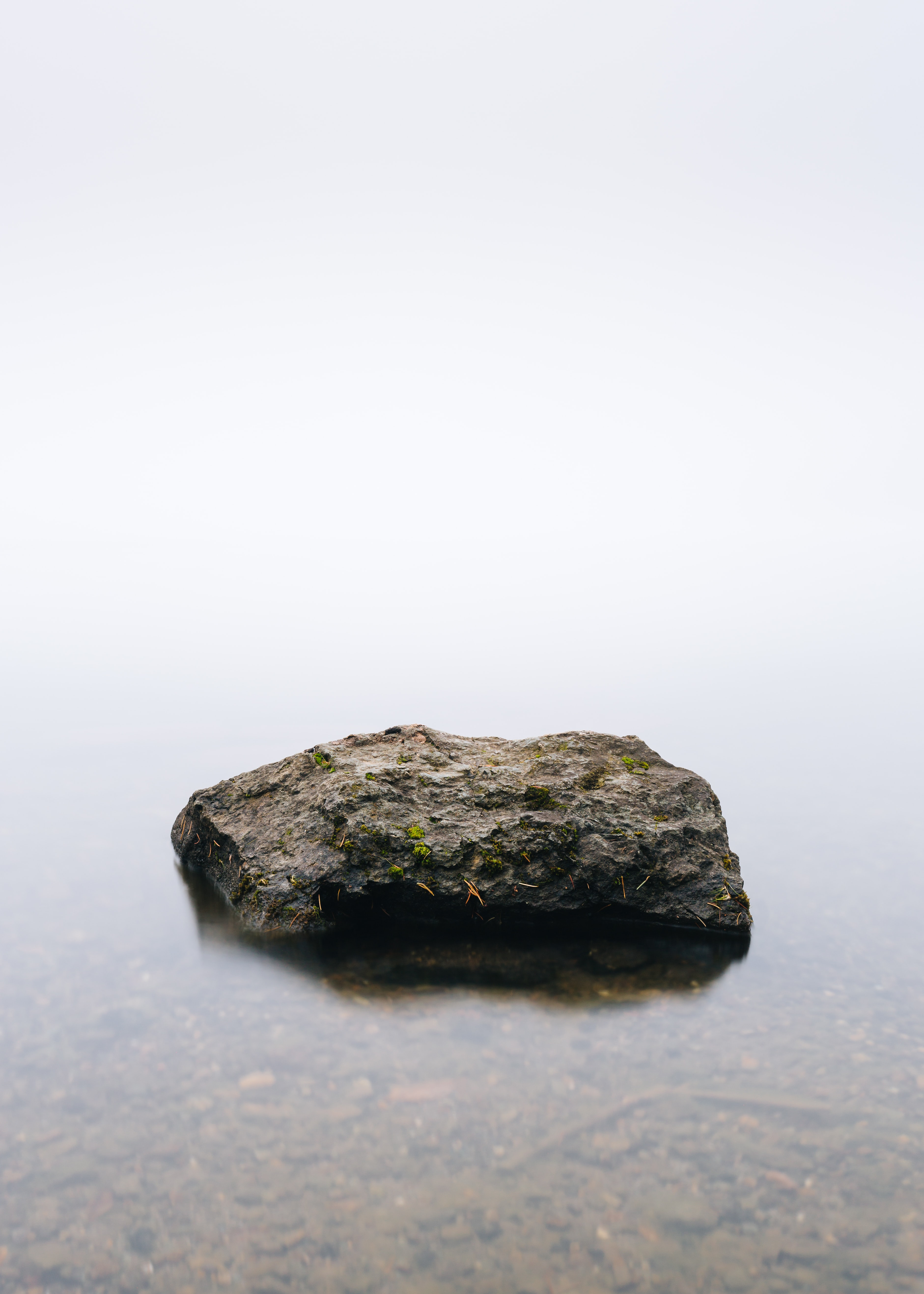 brown stone in body of calm water