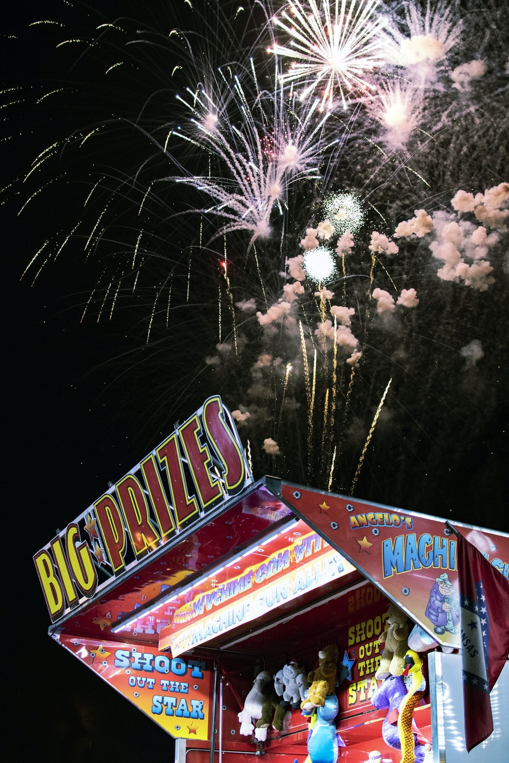 photograph of fireworks over shooting booth
