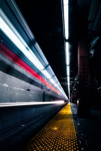 time lapse photography of train subway