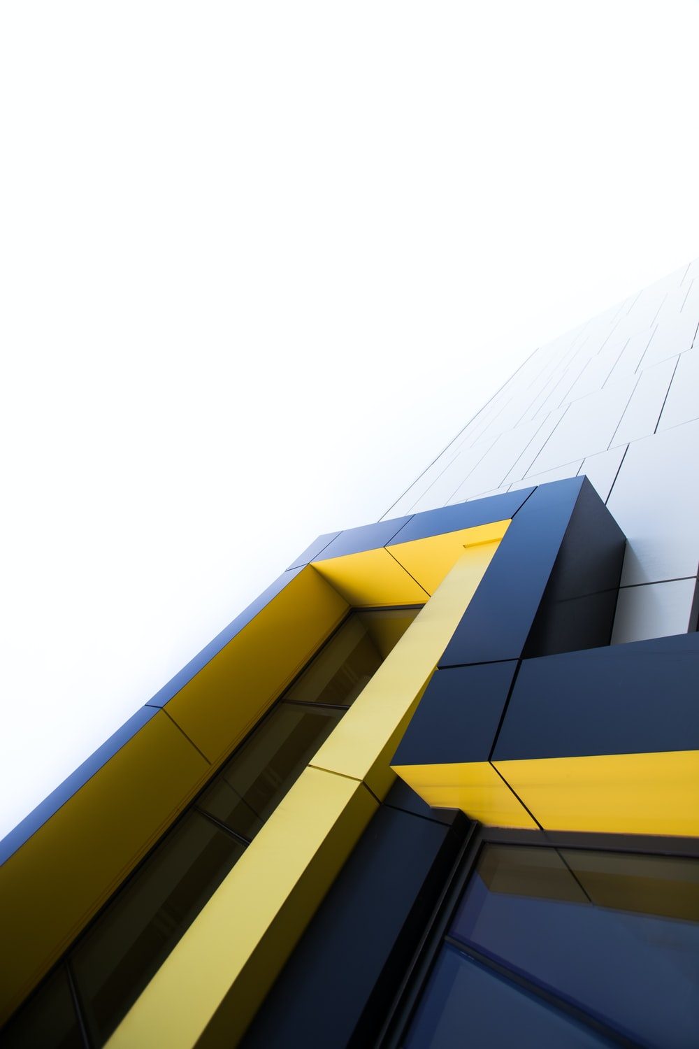 black and yellow building under white clouds