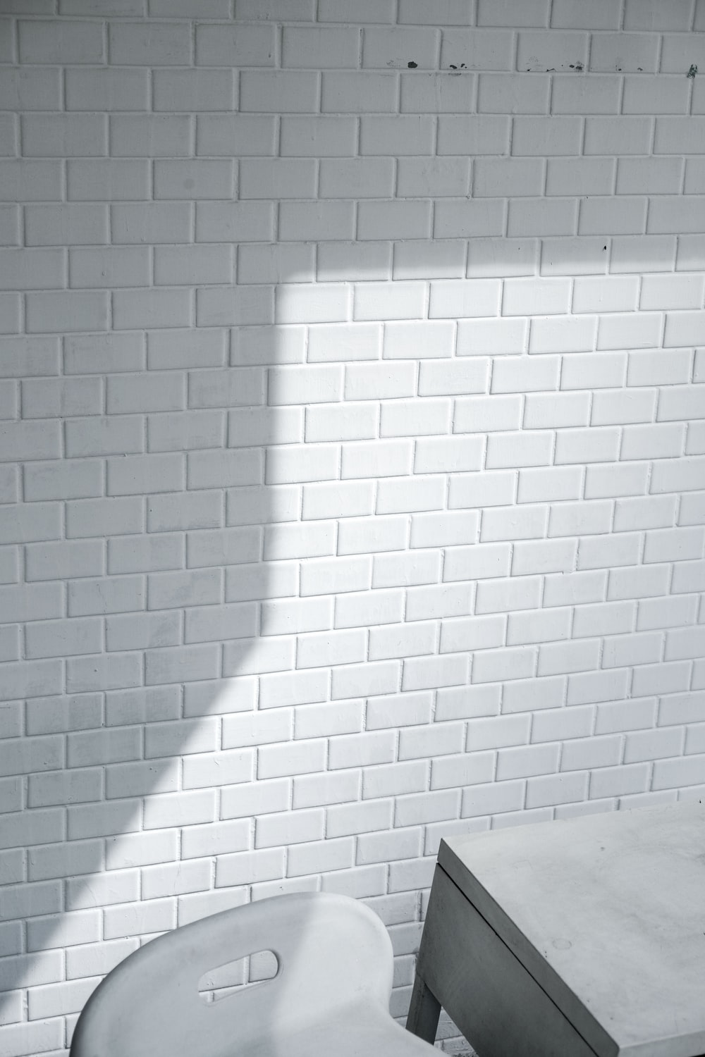 white wooden table beside wall
