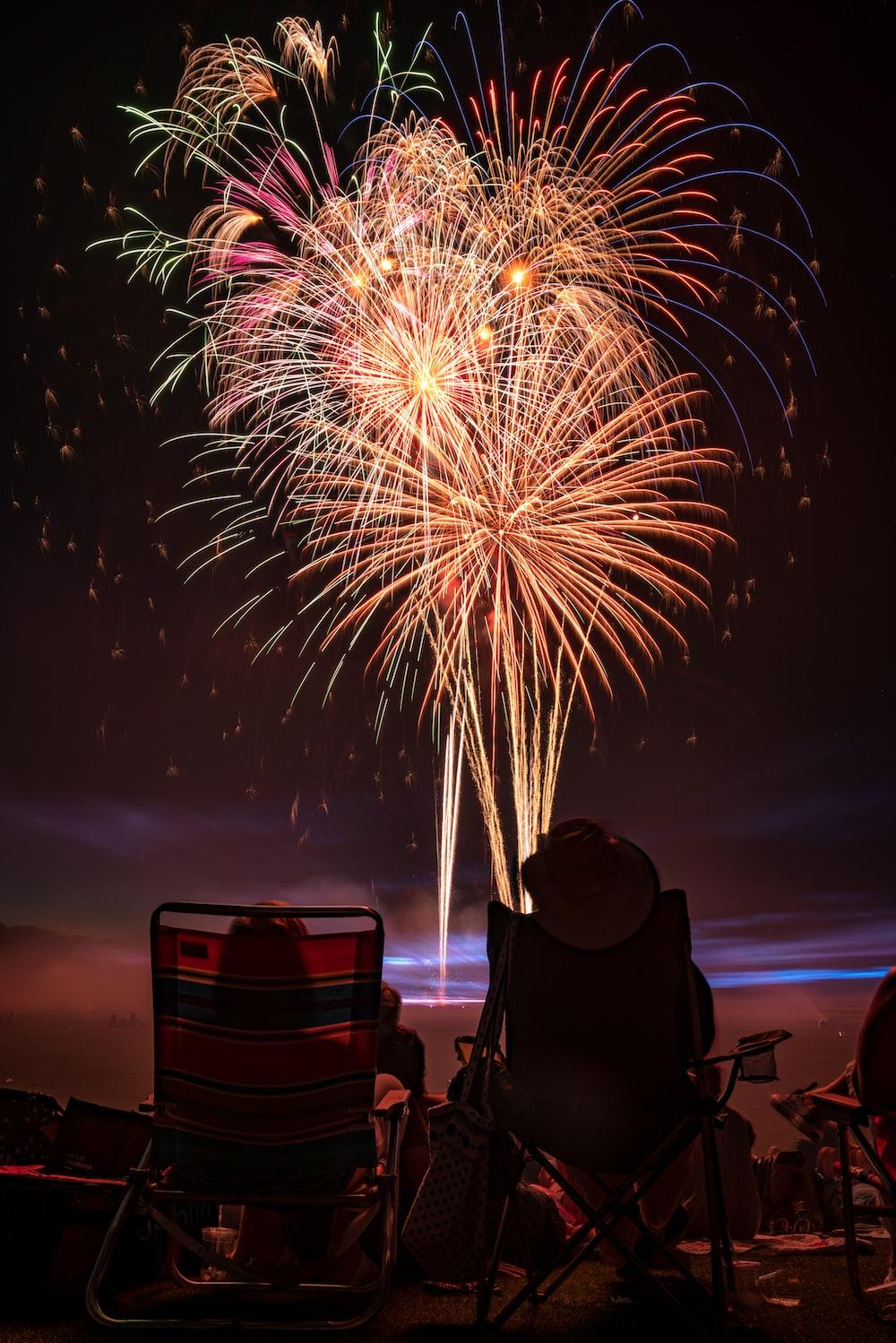 two people watching fireworks display