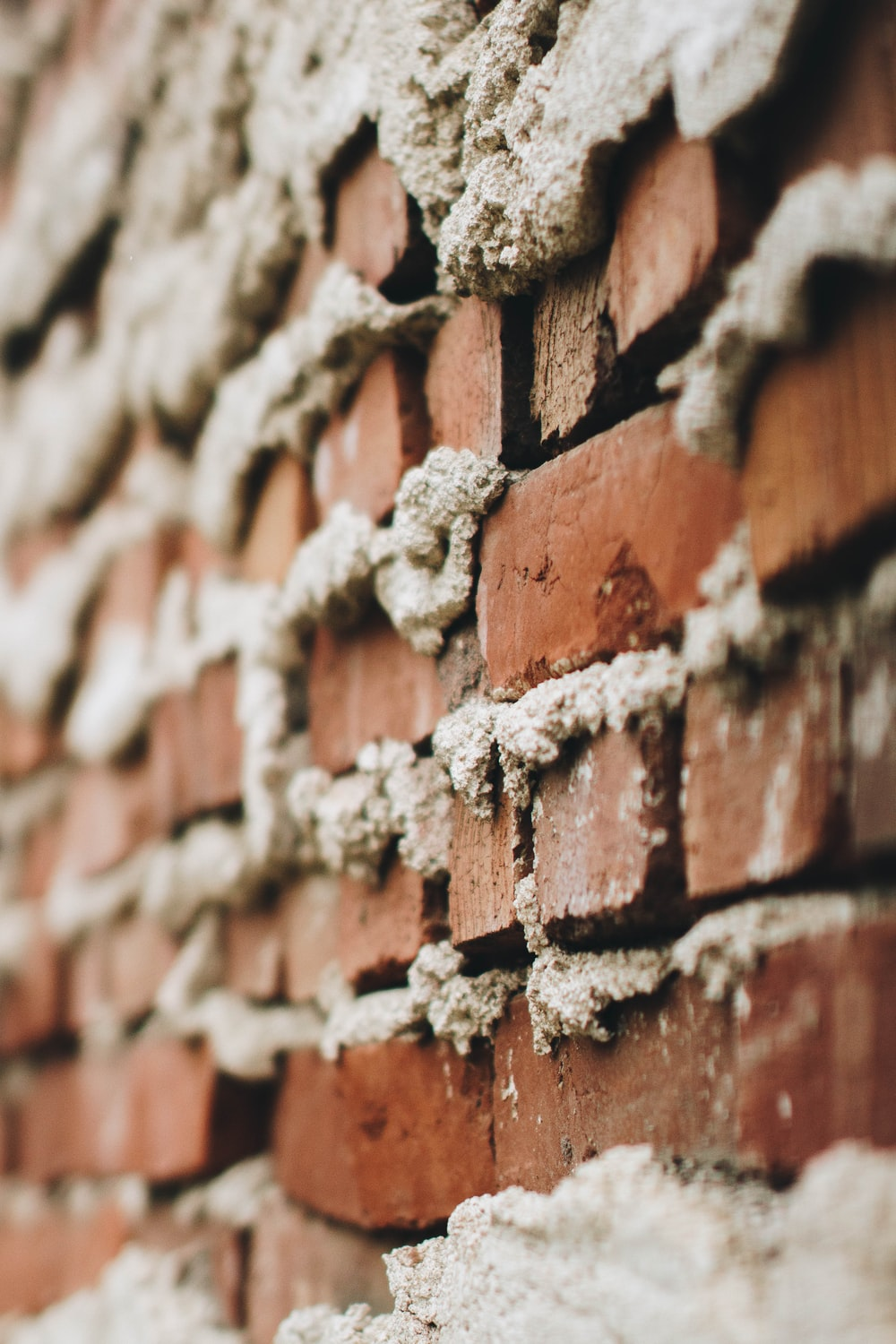 brown bricked concrete wall