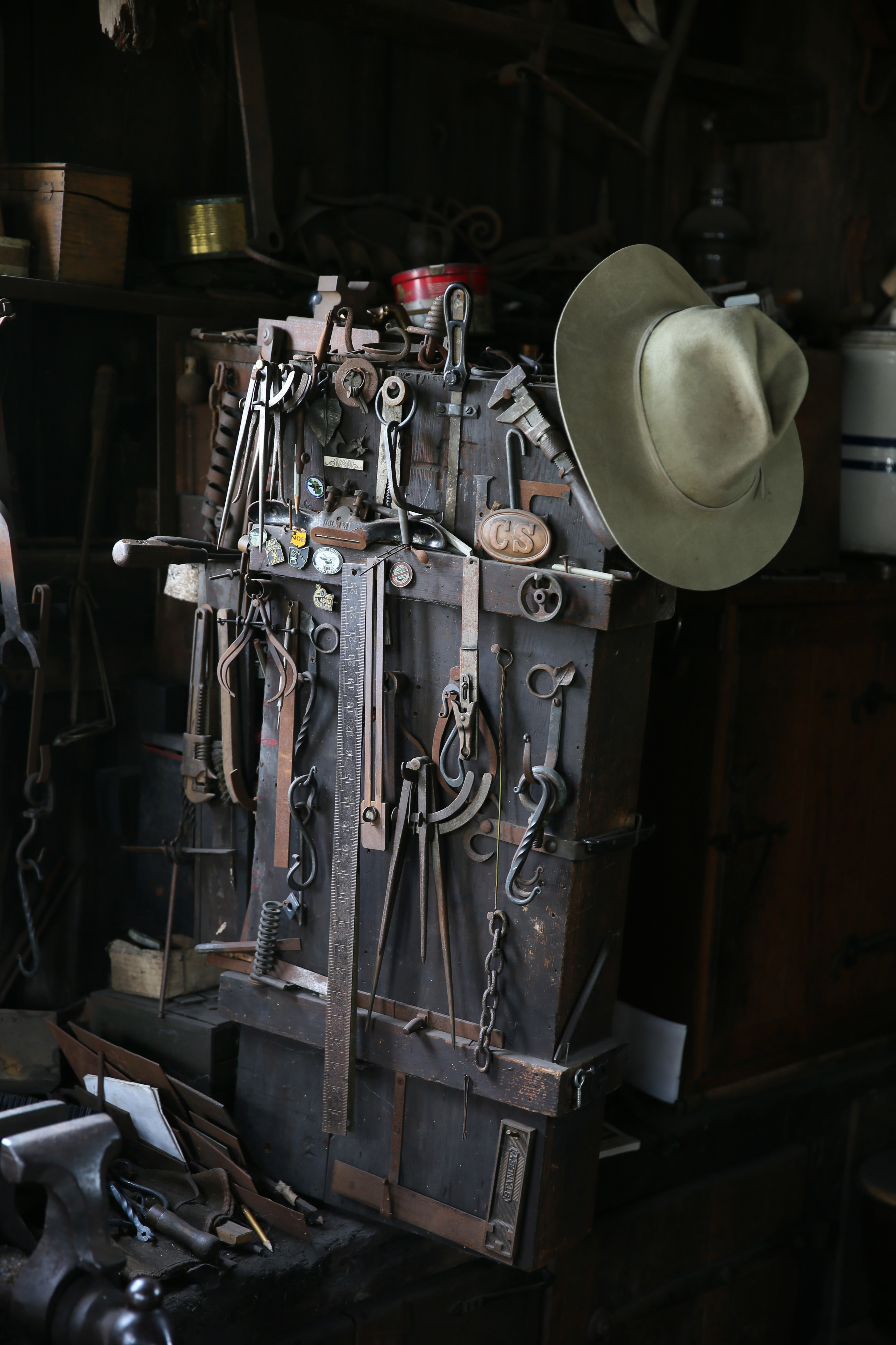 gray cowboy hat and mechanical tools