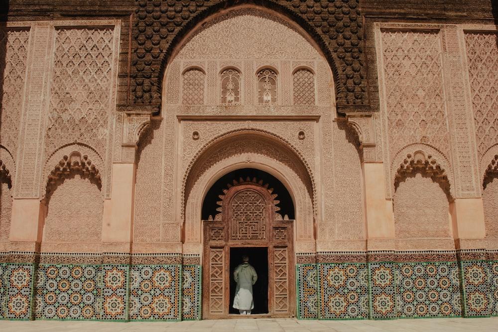 person standing on opened door of building