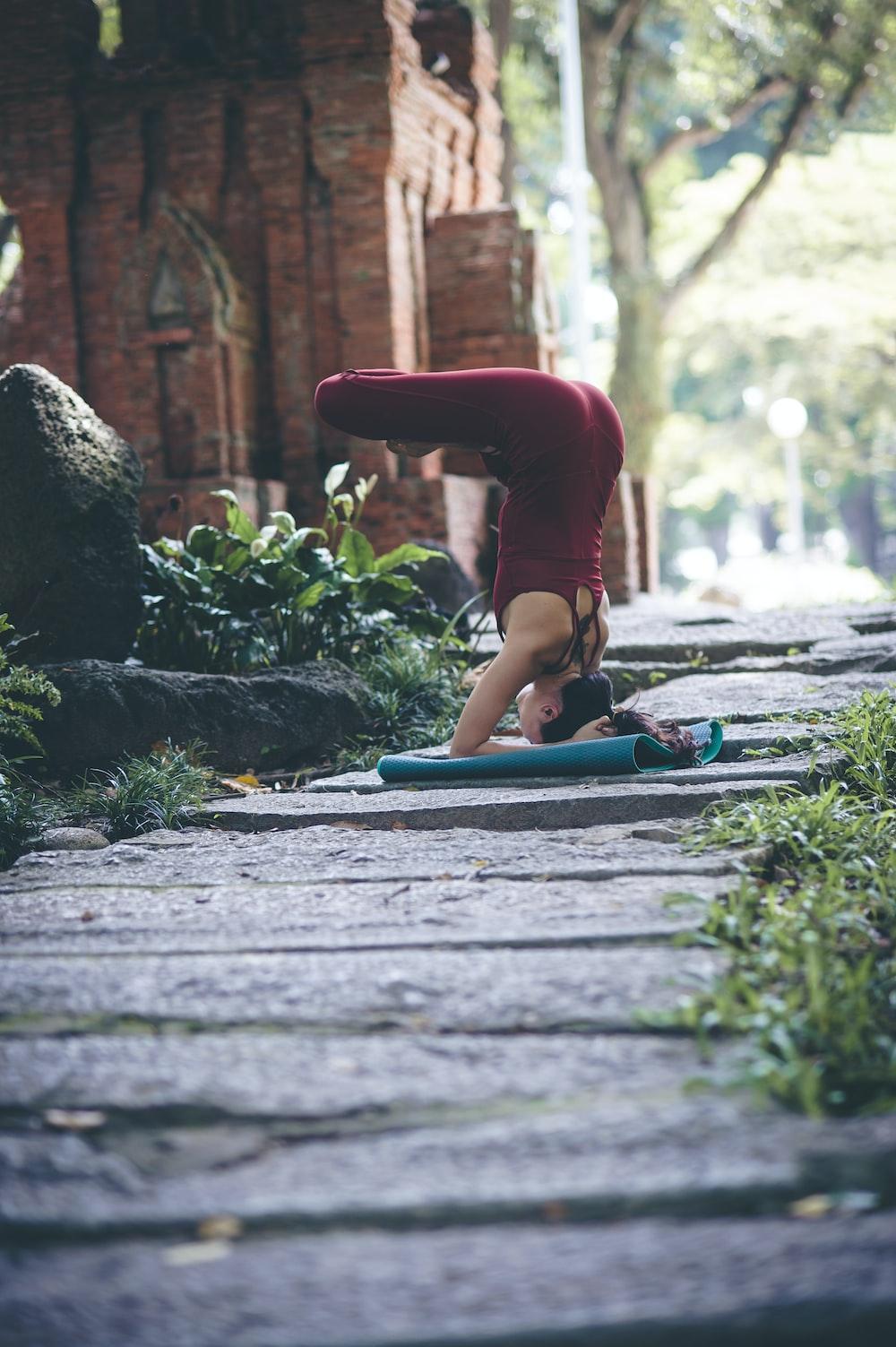 woman doing yoga pose outdoors