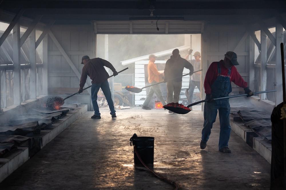 group of people lifting shovel