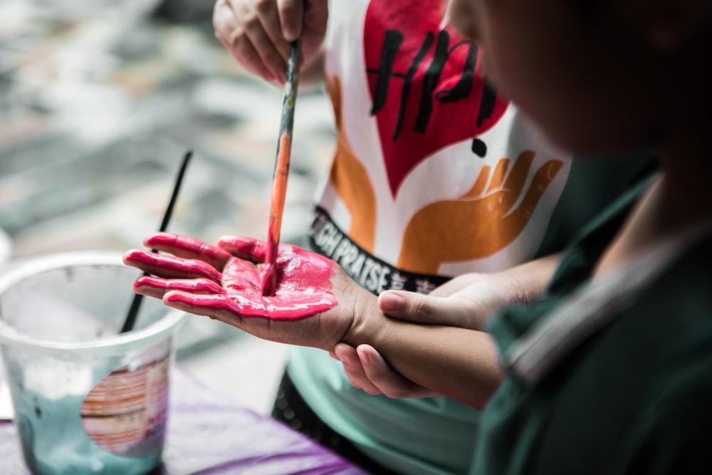 person holding paintbrush