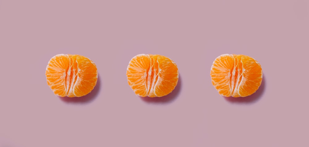 three orange fruits