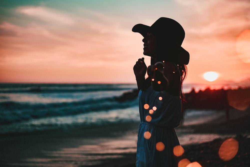 woman in seashore during golden hour