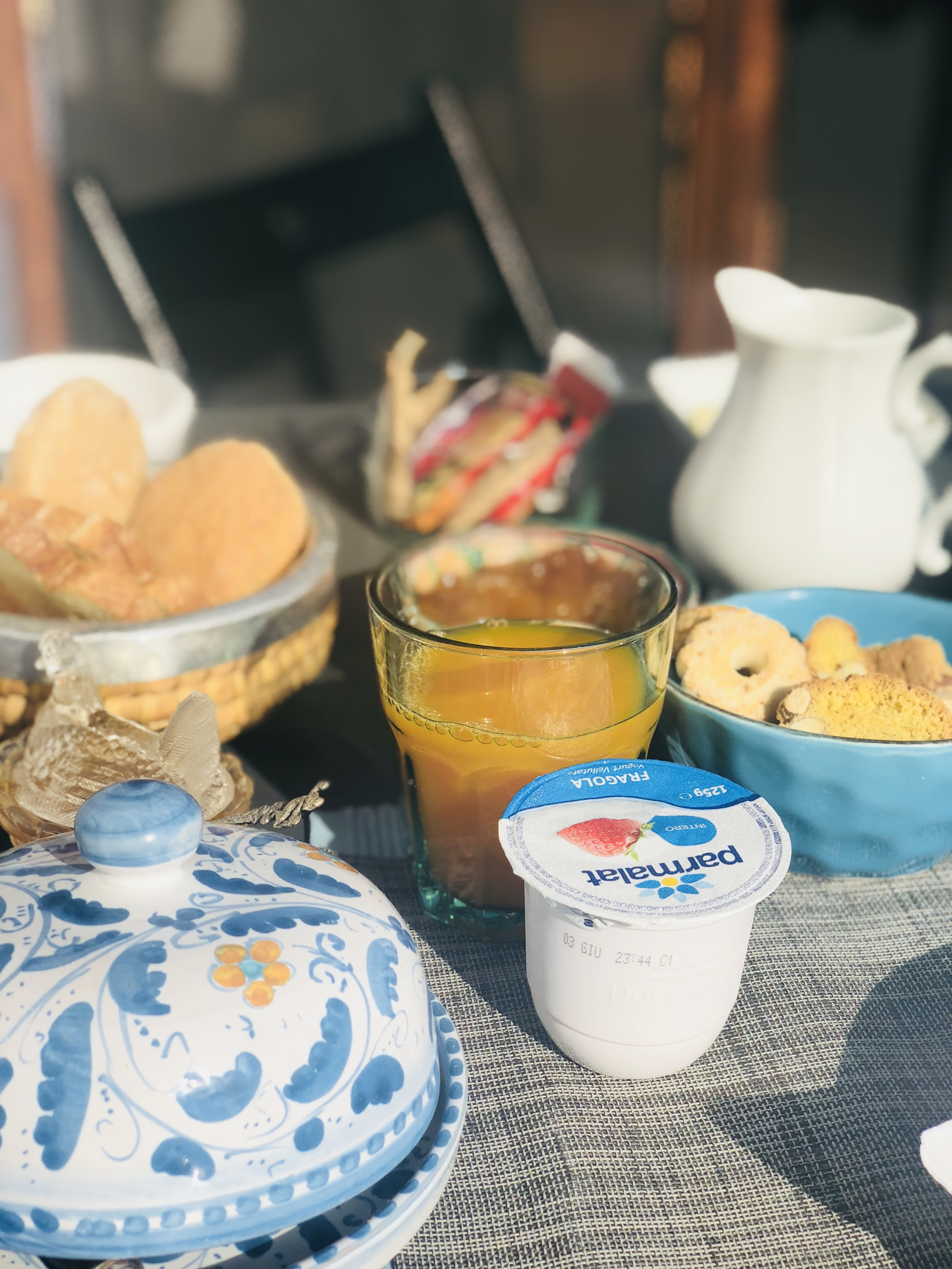 cookies near orange juice and Parmalat container