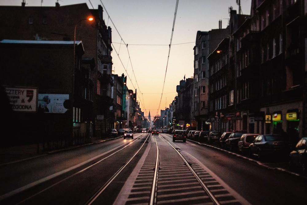 person taking photo of train rails