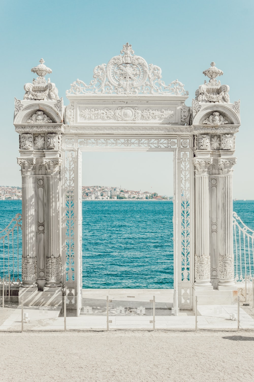 gray pillars near body of water