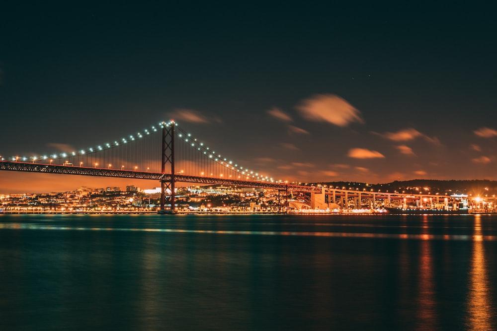 bridge over body of water during night