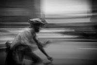 panning photography of man riding bike