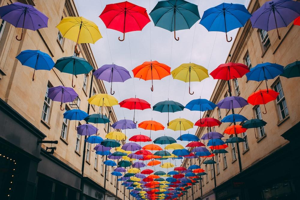 assorted-color floating umbrella lot near building