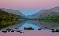 landscape photography of mountain range and lake