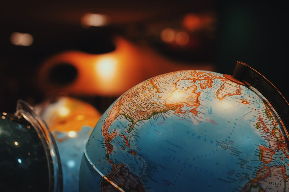 selective focus photo of terrestrial desk globe