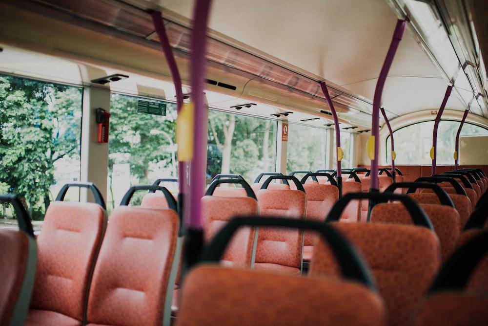 orange vehicle seat inside vehicle