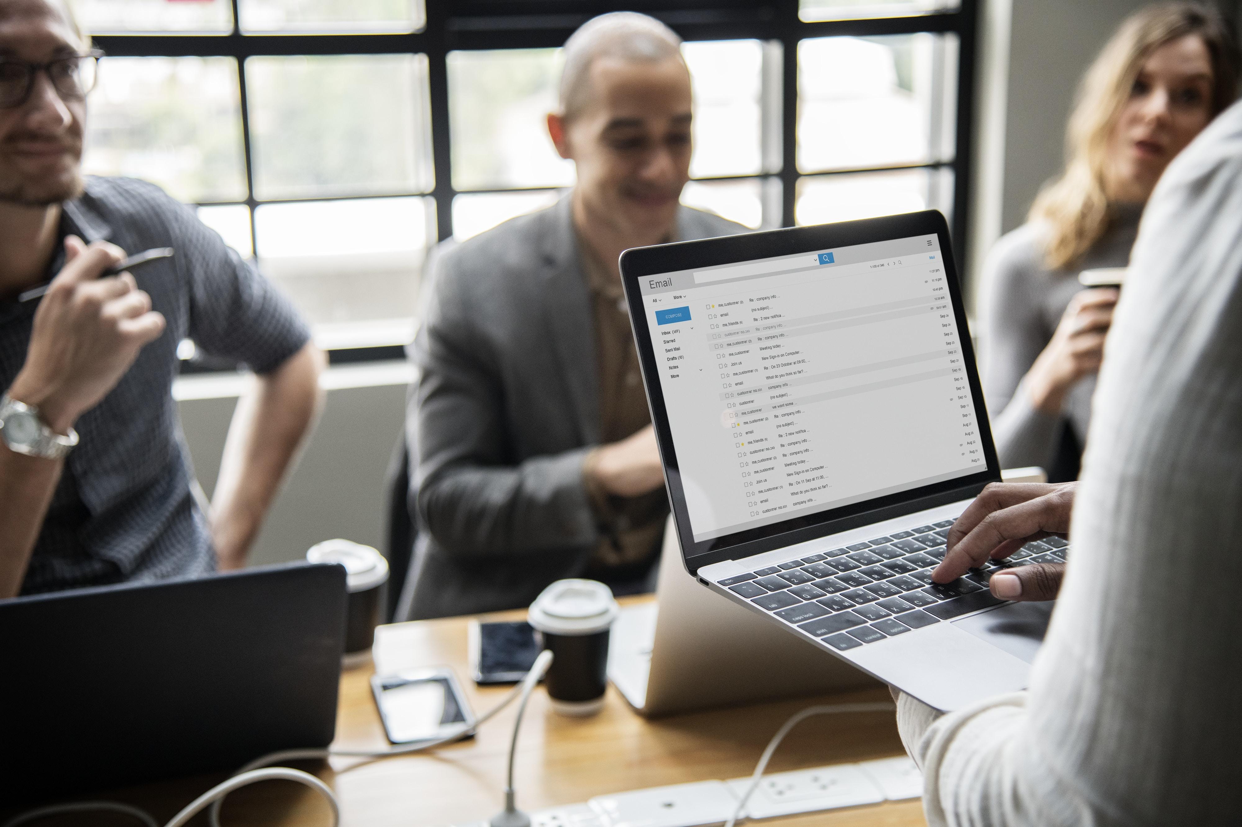 group of people having meeting using laptop computers