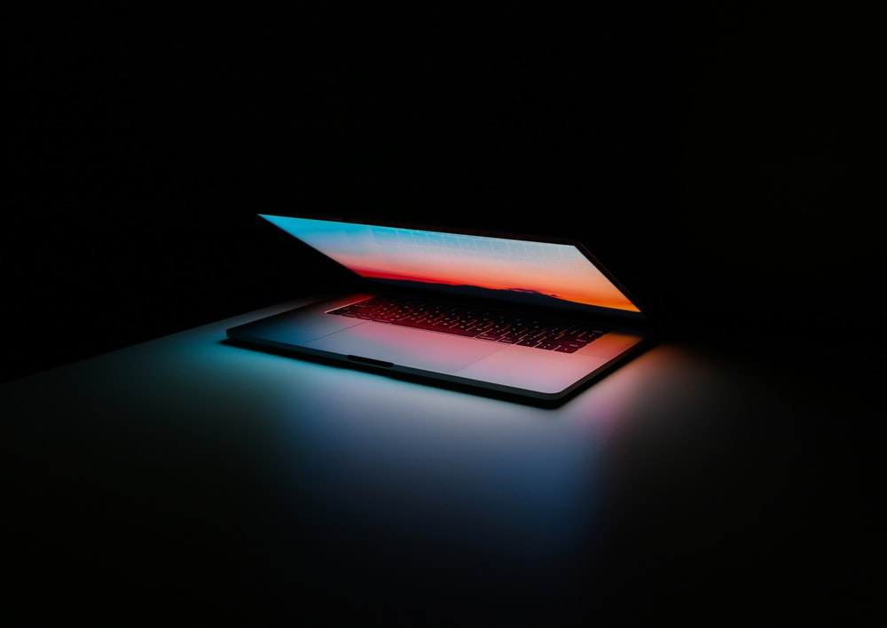 gray and black laptop computer on surface