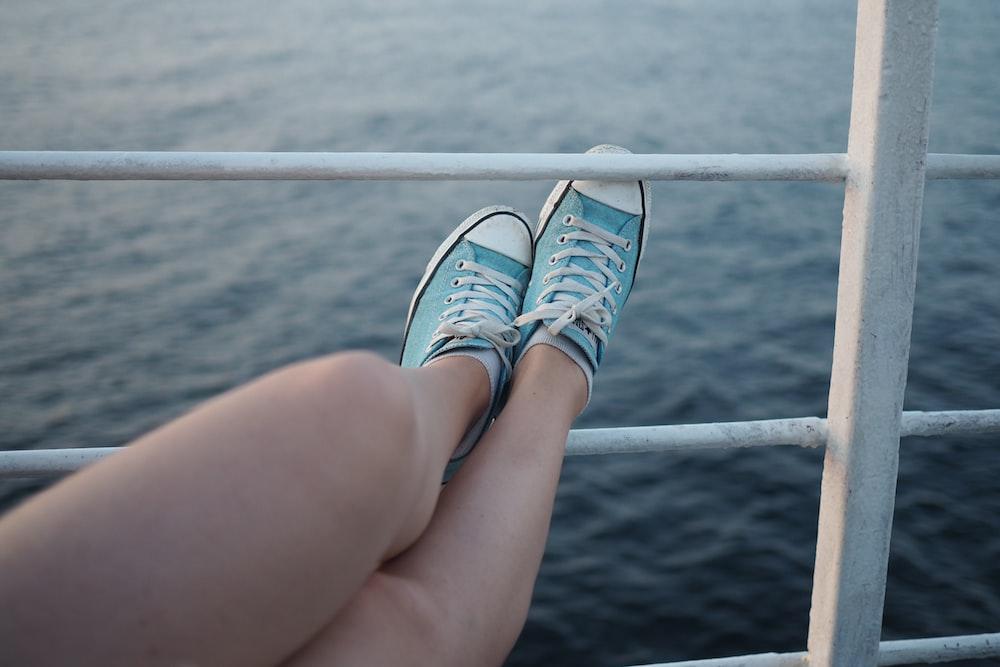 woman wearing low-top sneakers