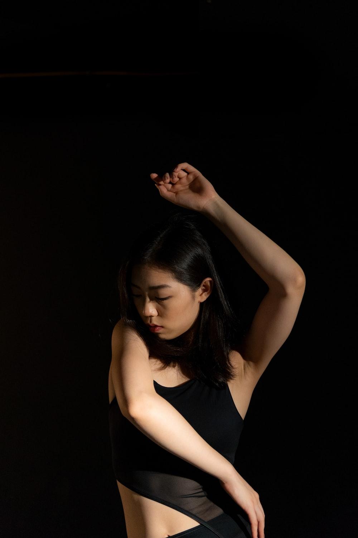 dancing woman against black background