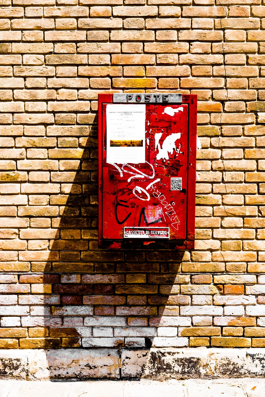 rectangular wall-mounted red metal case