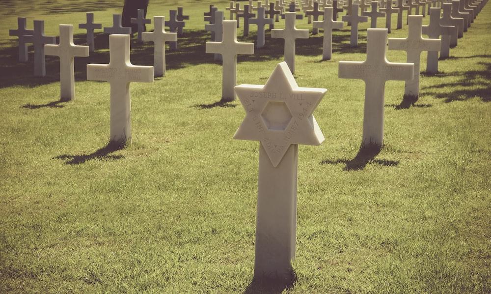 gray tombstone in graveyard