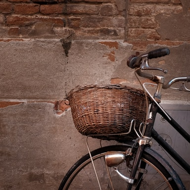 black and grey cruiser bicycle leaning on wall