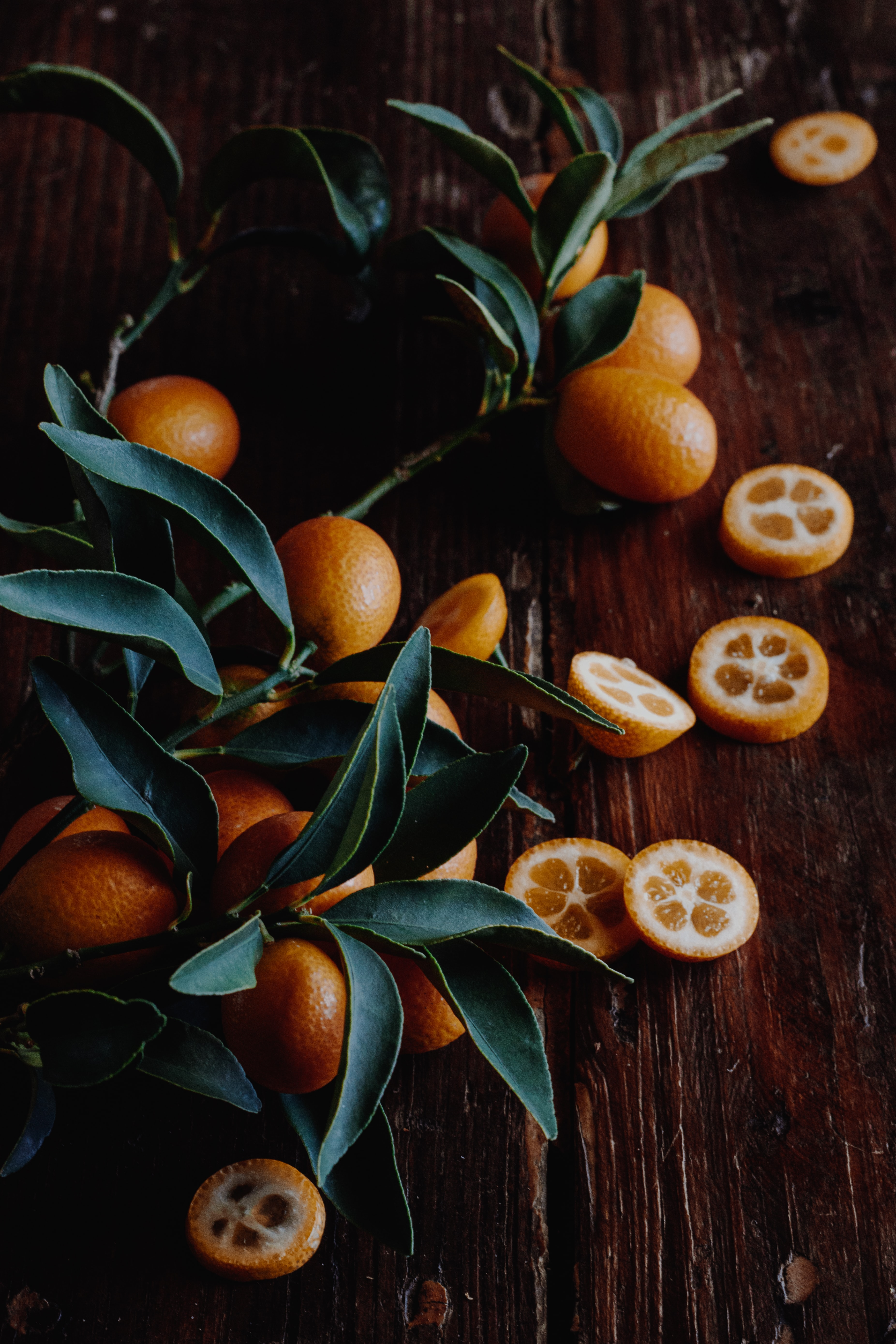 orange fruits on brown wood
