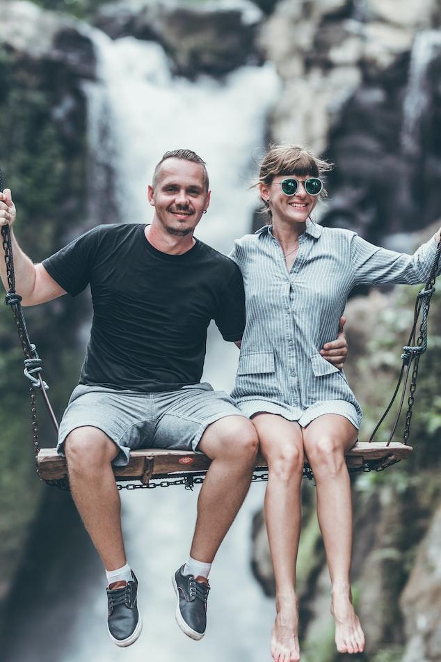 A couple in Bali swing