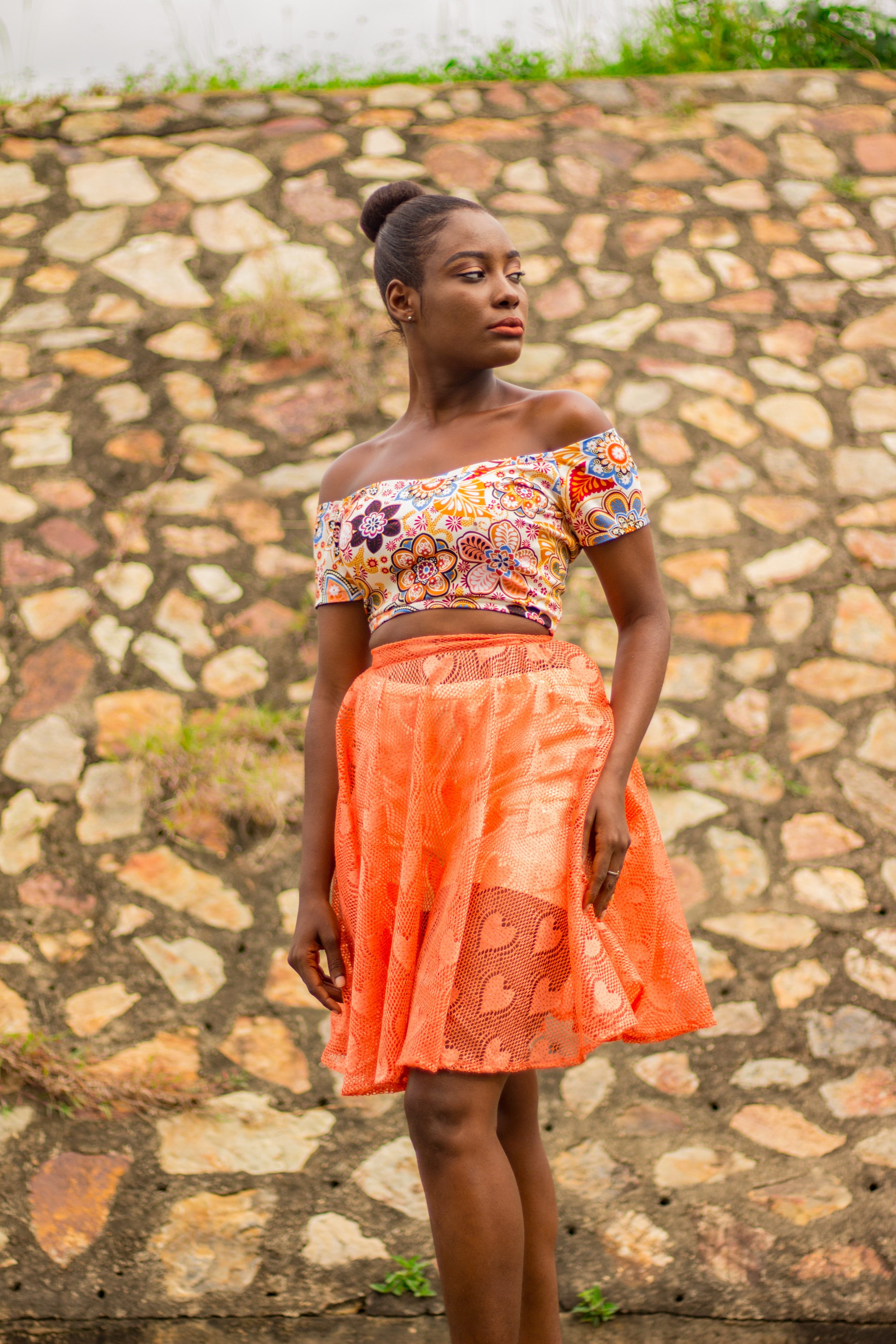women's white and multicolored floral crop top with orange mini skirt
