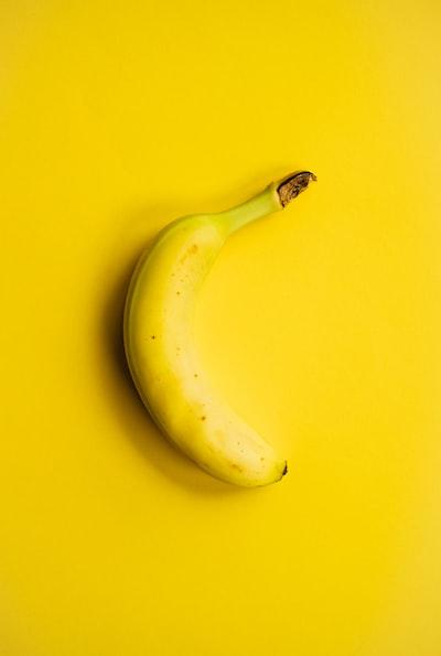 yellow banana fruit on yellow surface