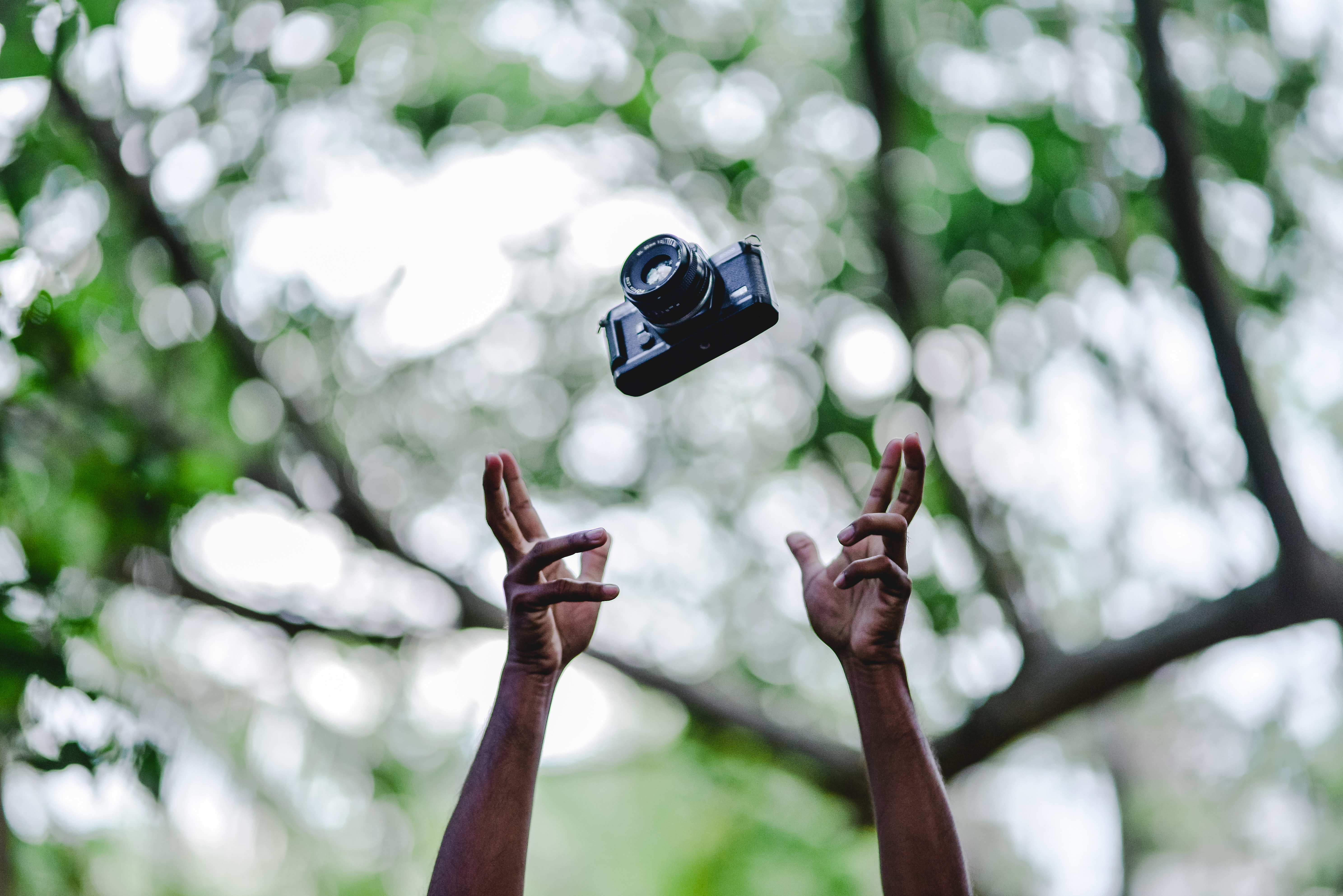 person throwing DSLR camera