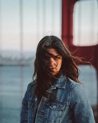 photo of woman wearing blue denim Western jacket