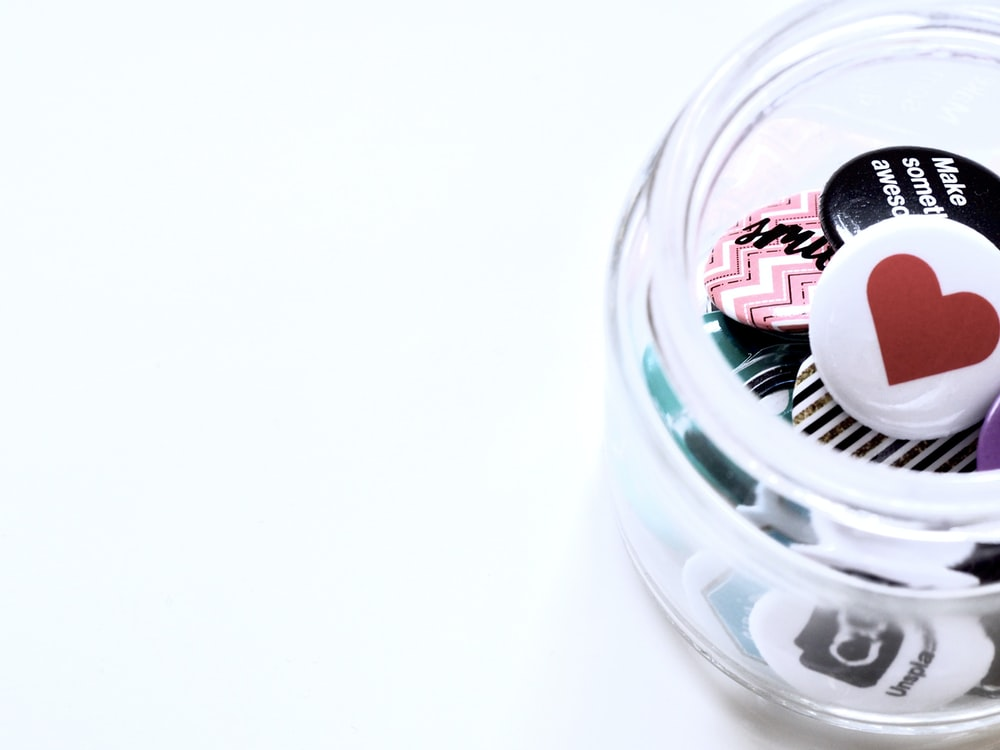 clear jar with buttons