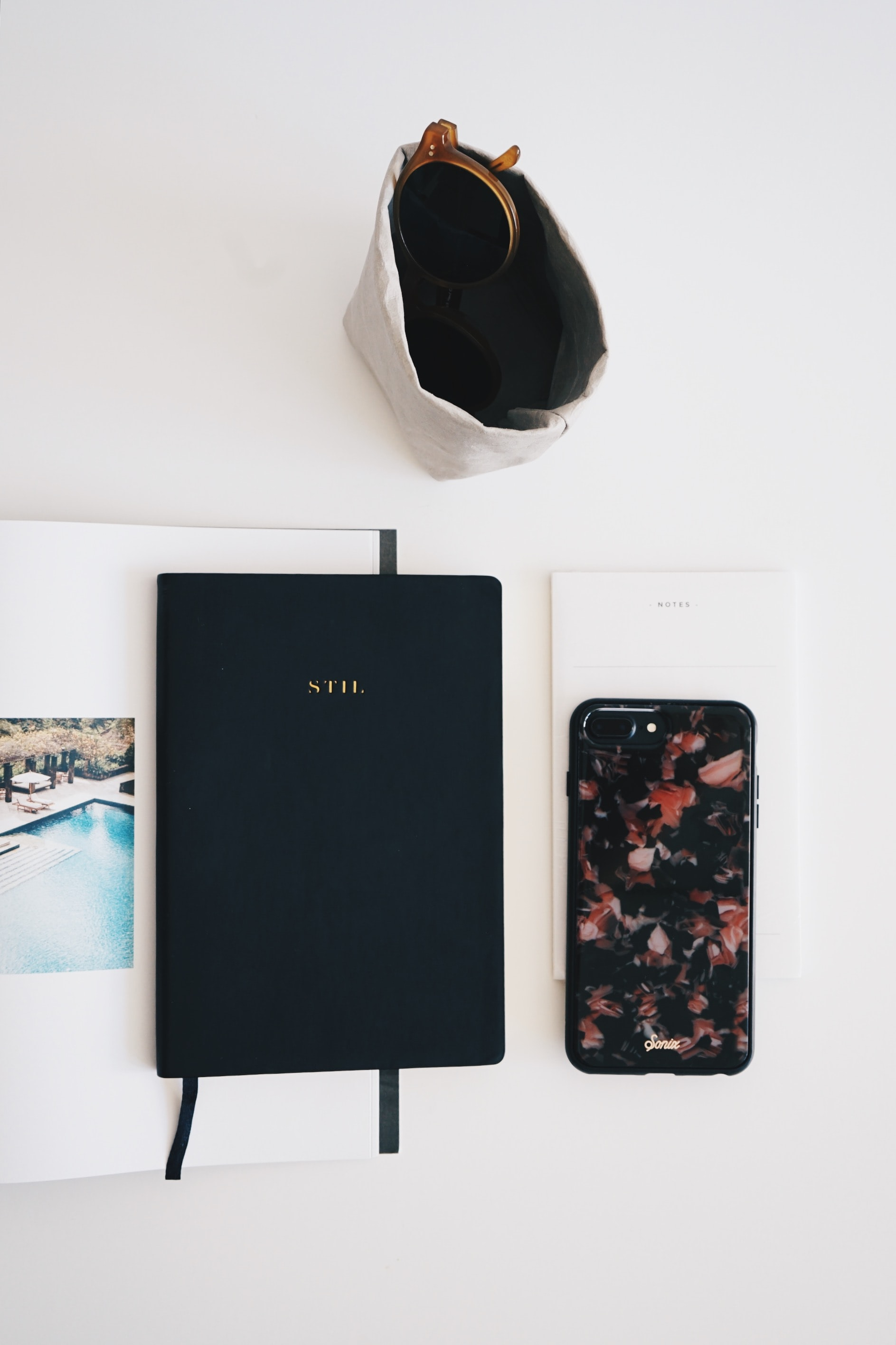 pink and black iPhone case beside black case