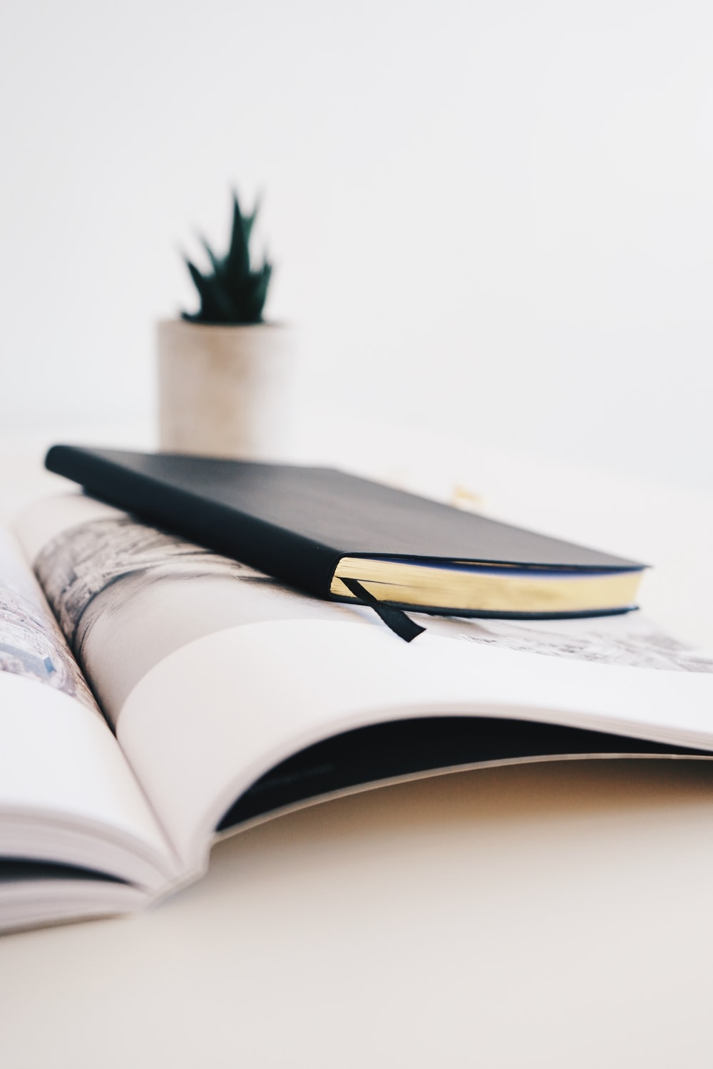 black book on white wooden surface