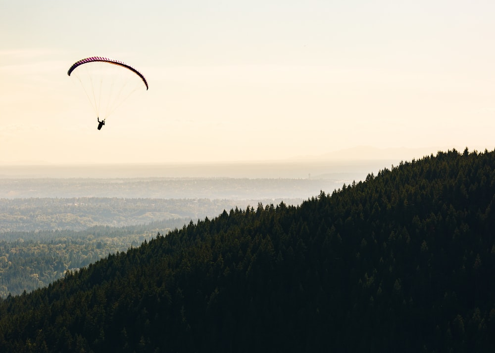 person paragliding near mountain