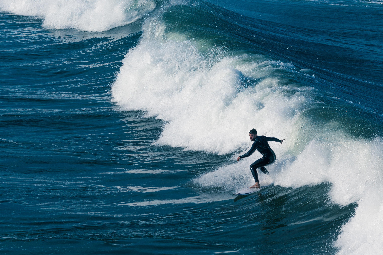 man surfing under sunny sky