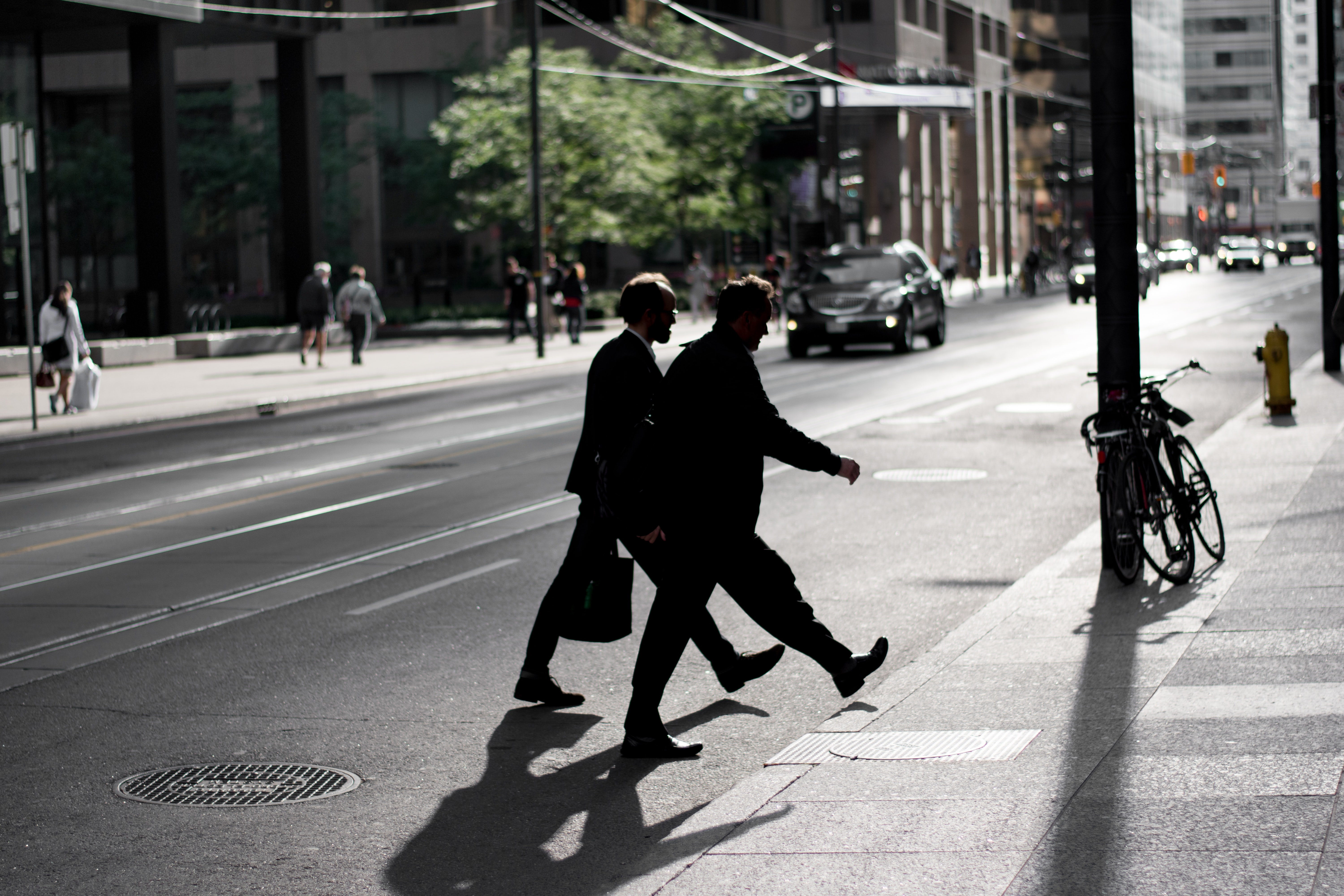 silhouette photography of man walking on road