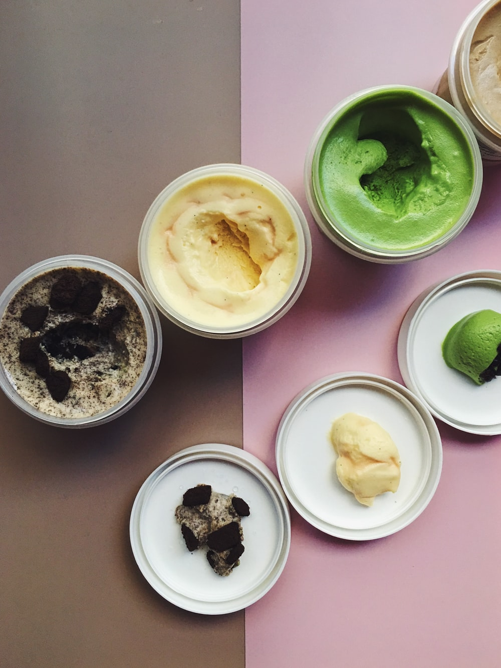 ice creams in white plastic containers
