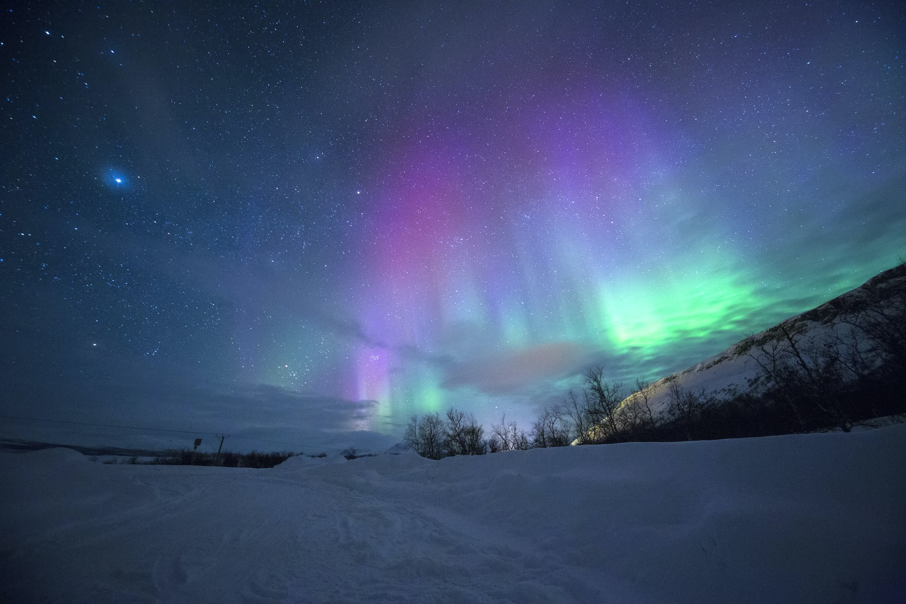 northern lights over snow-capped mountian