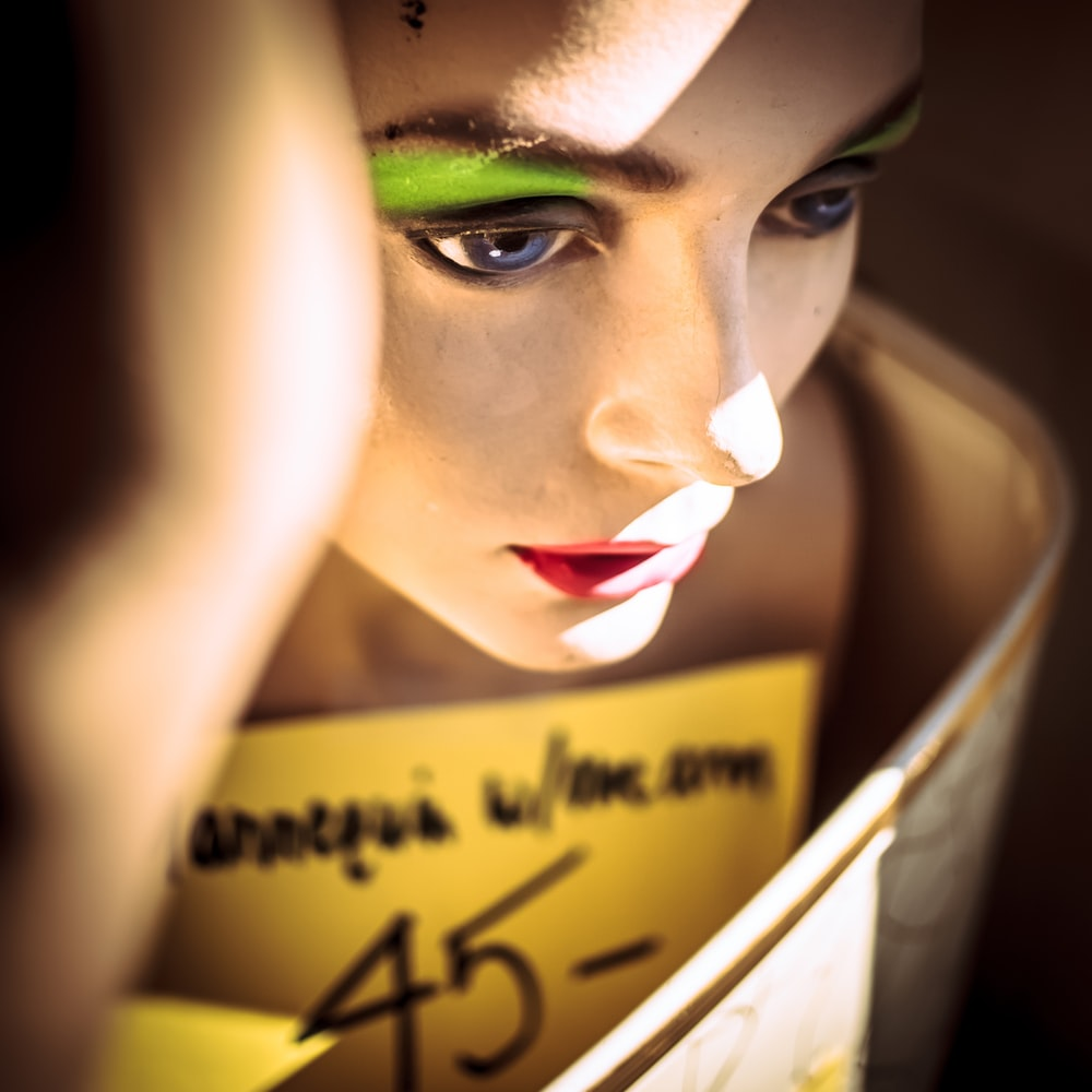 woman with green eyeshadow and red lipstick