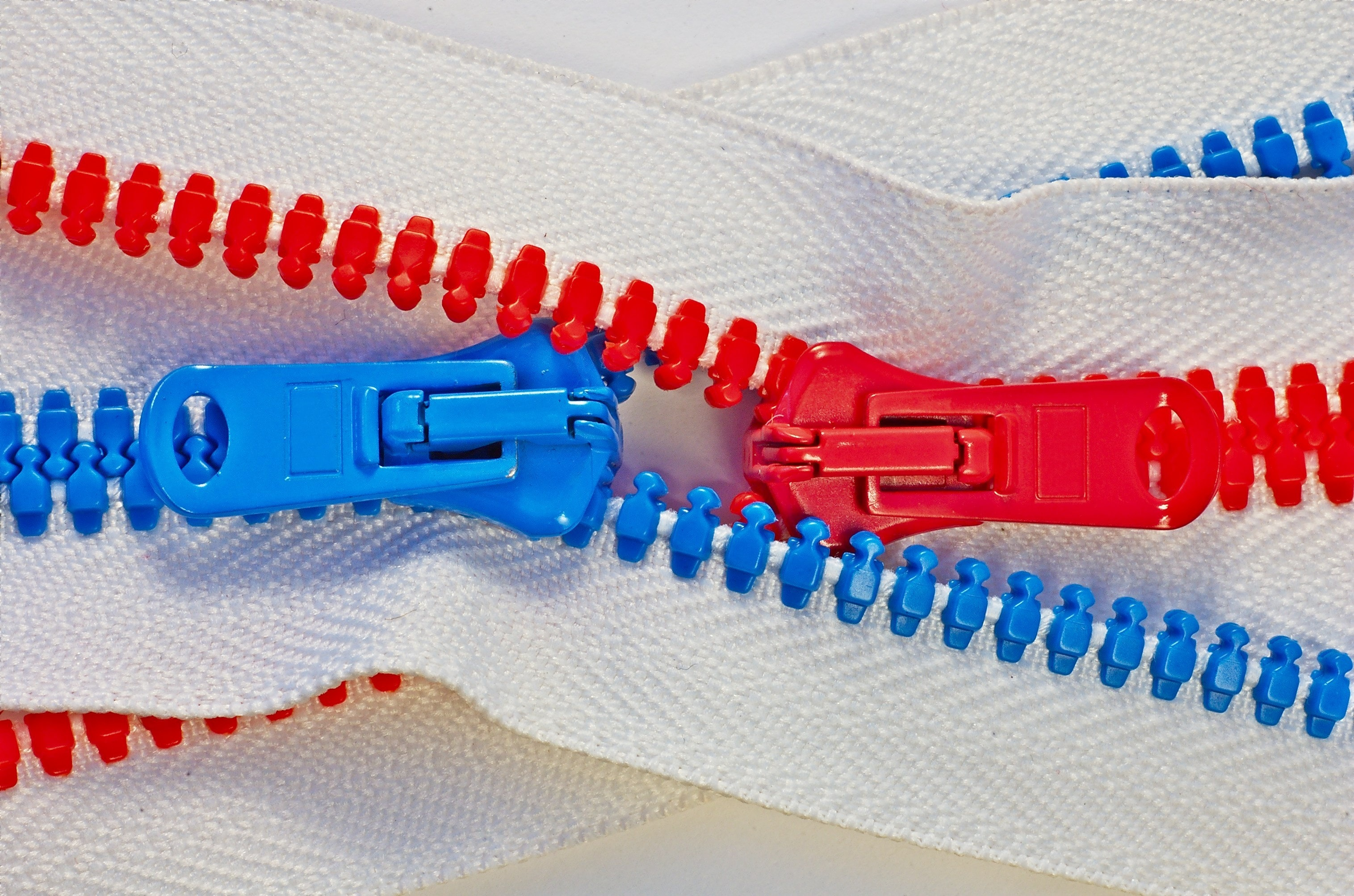 two red and blue zippers