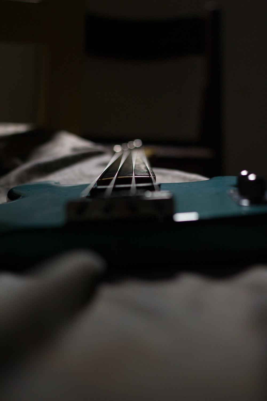 green and black bass guitar